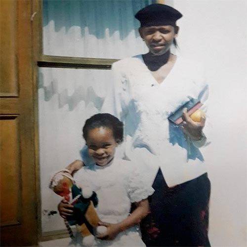 Luthando as a child with her mother